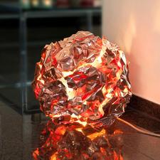 Eingeschaltet erscheint das Kupfer wie rotglühendes Gestein - mit gleissend hellen und dunkleren Partien.