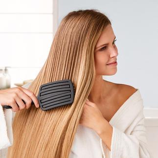 Touch & Glide Brush Entwirrt das Haar besonders schonend und massiert gleichzeitig sanft die Kopfhaut.