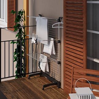 FlexiblerTurmwäscheständer Der flexible Wäscheständer: bis zu 40 m (!) Wäscheleine. Oder platzparend zur Hälfte eingeklappt. Inklusive Fussgestell.