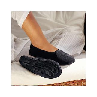Les chaussons de voyage Vous y serez aussi à l'aise que nu-pieds.