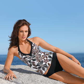 Der Tankini mit elegantem Blumenmuster: Femininer als ein Badeanzug, nachsichtiger als ein Bikini. Sieht auch zu hellem Teint gut aus. Kaschiert und streckt die Figur.