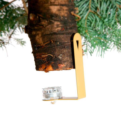 Am Baumstammende befestigt, beleuchtet das mitgelieferte LED-Licht dezent Ihre Geschenke.