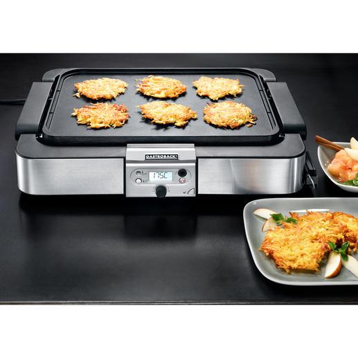 Auf der glatten Platte gelingen auch Kartoffelpuffer, Gemüse und Meeresfrüchte perfekt.