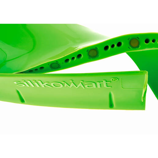 Durch integrierte Magnete haftet die Unterkante fest am Backblech und schliesst dicht ab.