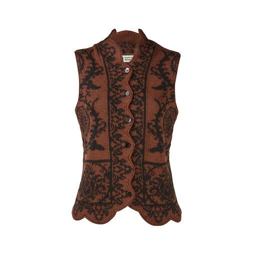 Die feminine, formstabile Ornament-Weste aus edlem Alpakahaar. Elegant gemustert. Schmeichelhaft figurbetont. Und doch so behaglich wie normale Strickwaren.