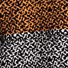 Creme/Schwarz/Orange